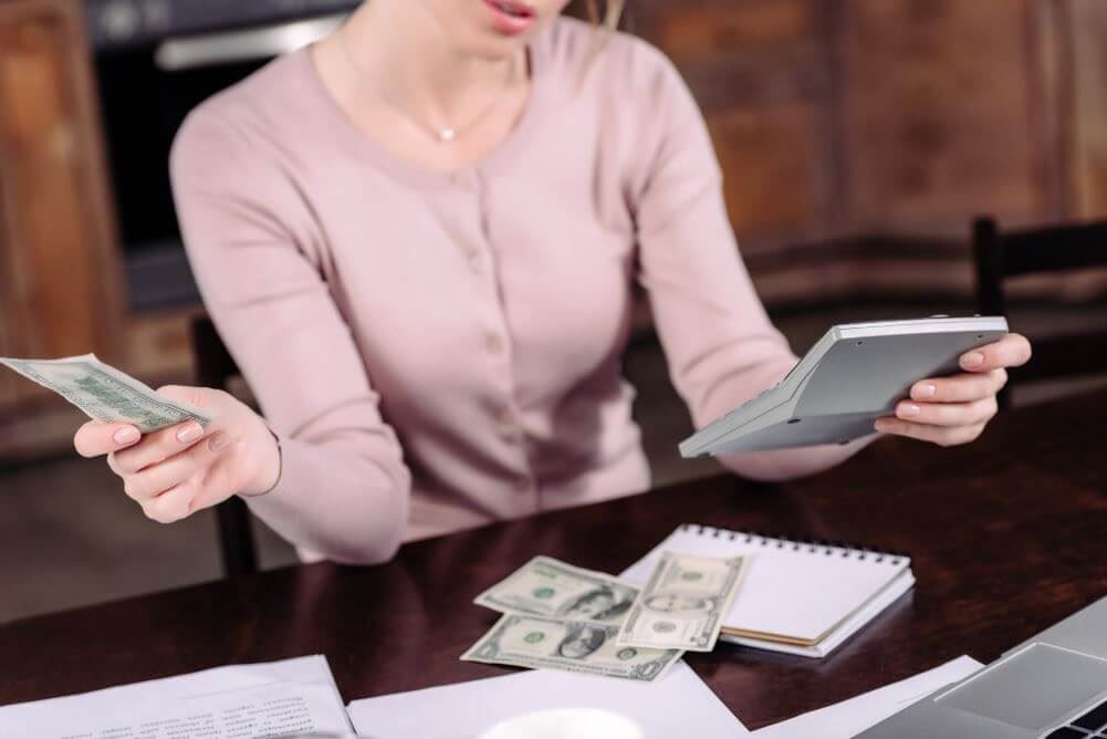 Woman counting money - counting cost of separation